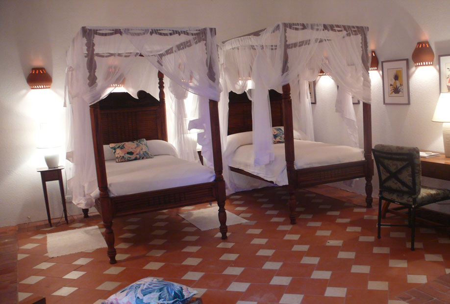Lower Level Bedroom with 2 Full-Size, Four-Poster Beds with Adjoining Bathroom
